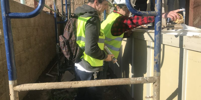 Pre-apprenticeship students work on job site